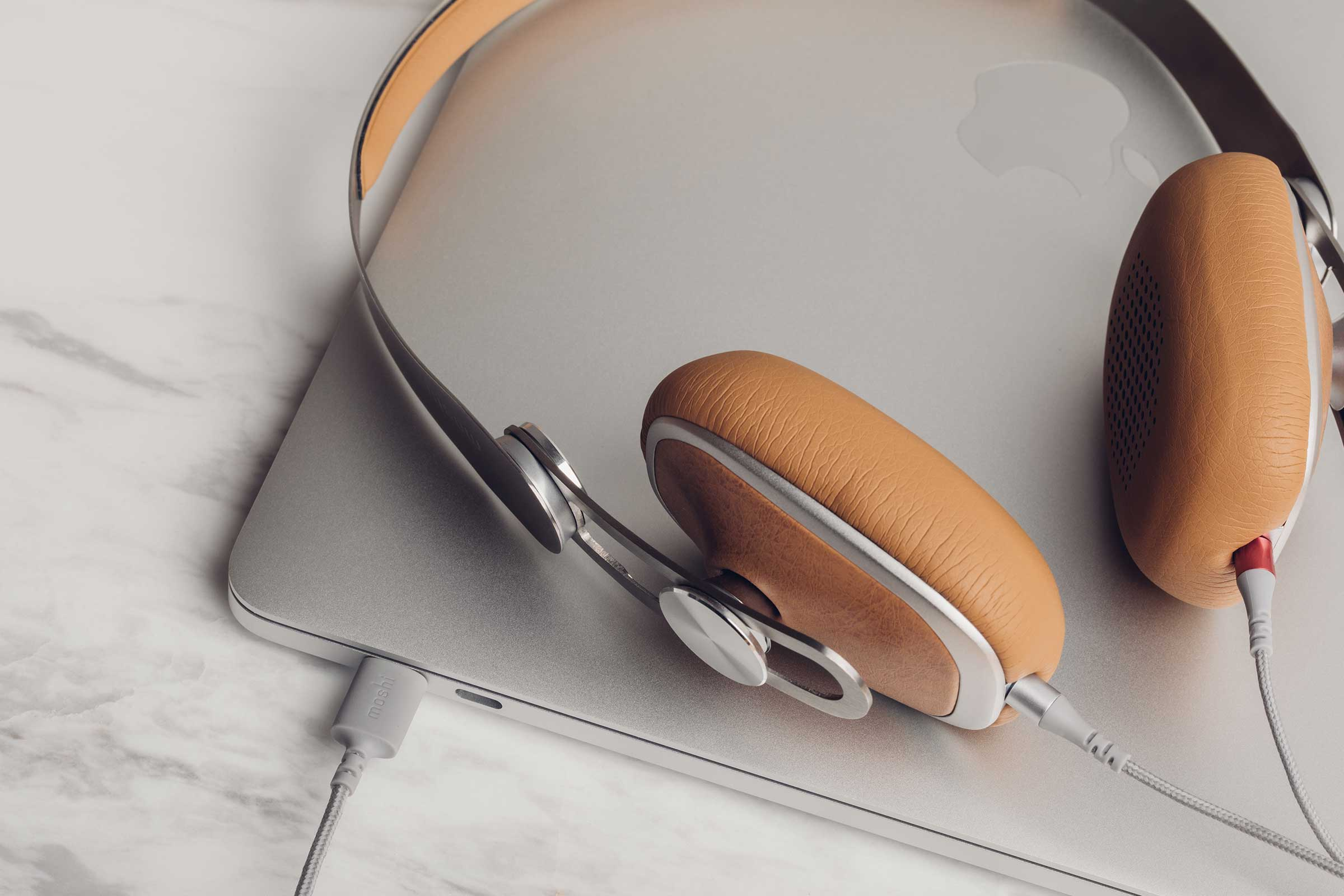 Moshi's Avanti C headphones plugged into a MacBook for high-quality sound.