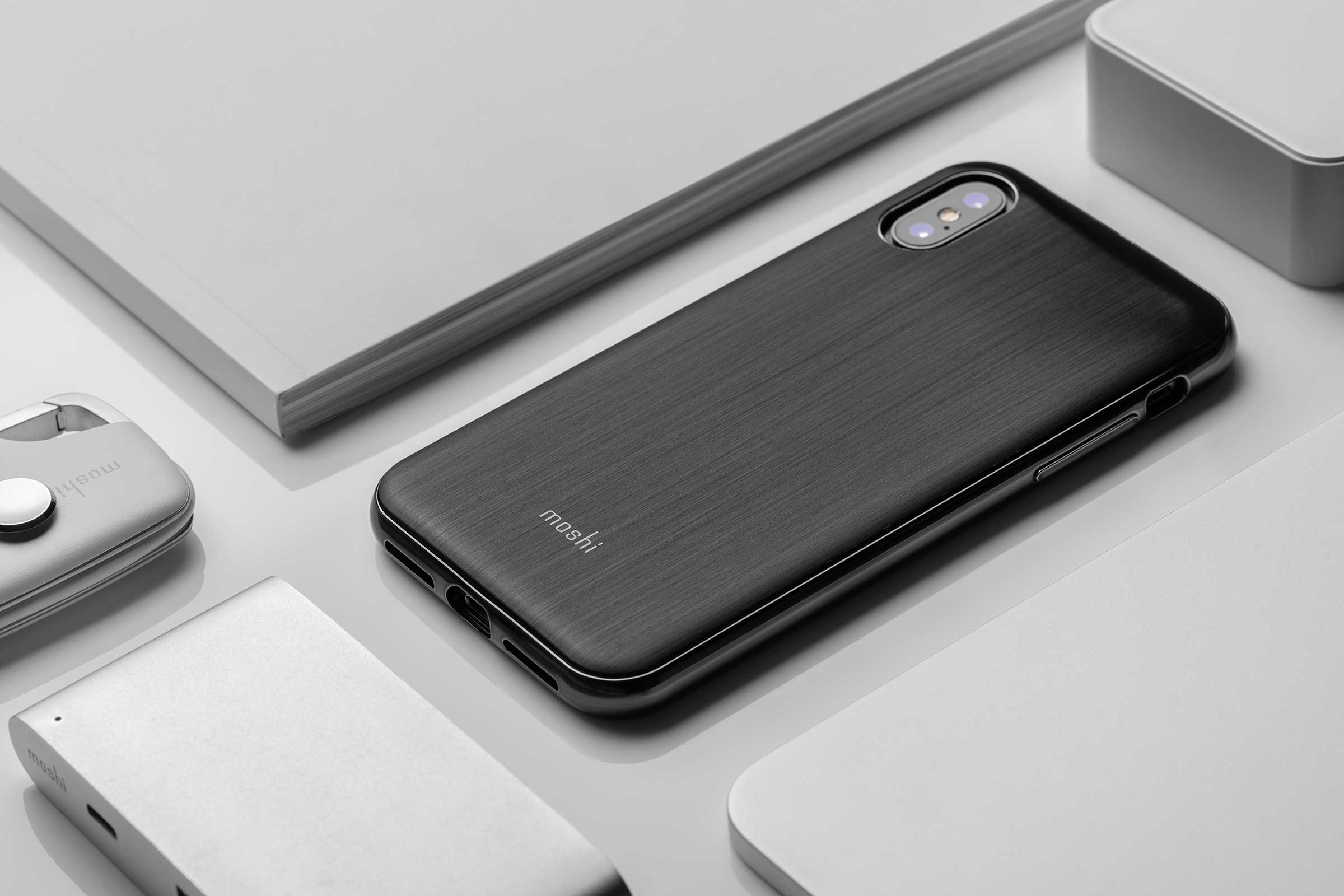A select range of accessories arranged geometrically, with iGlaze for iPhone as the focus.