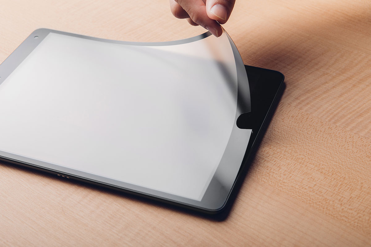An iVisor screen protector being installed on an iPad.