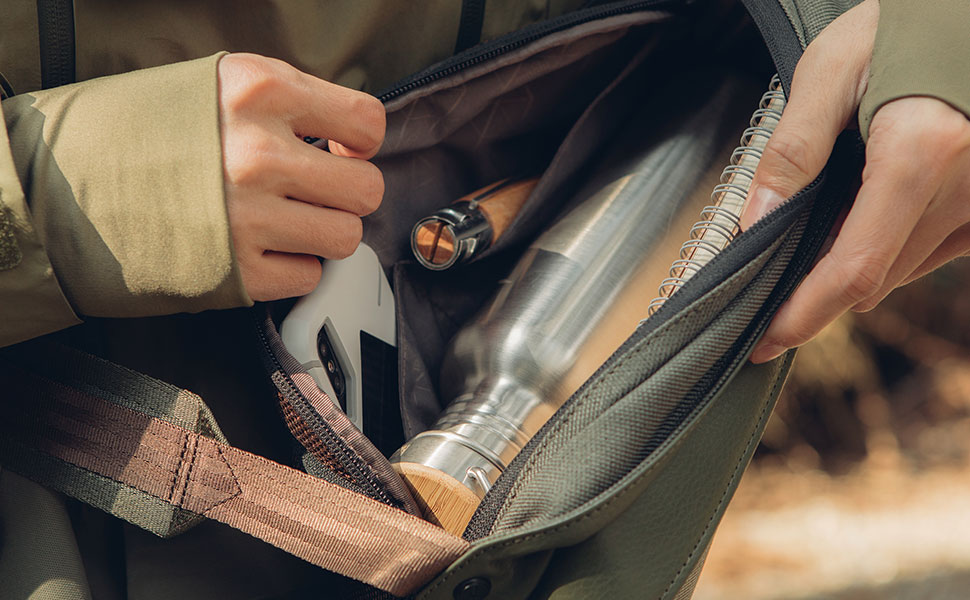 A compact interior includes some compartments for smartphones and other small devices.