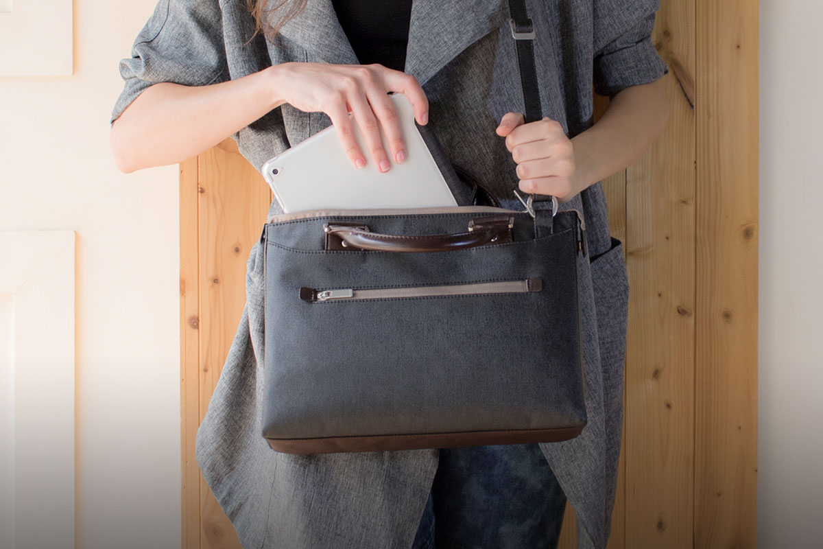 A padded laptop/iPad compartment cushions your device from shocks and bumps.